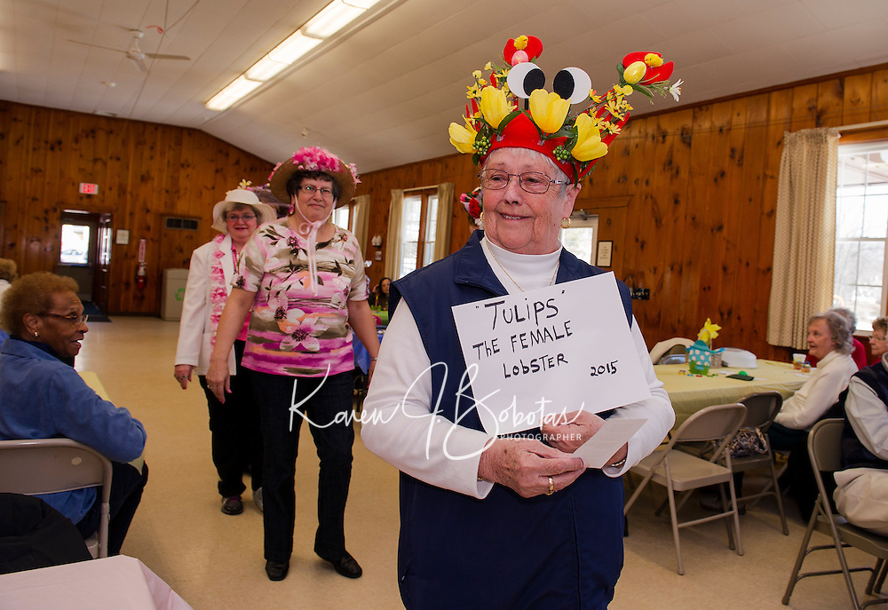 """Lorraine Parkhurst wearing """"Tulips"""" during the Easter Bonnet parade on Wednesday afternoon with the Laconia Elders Friendship Club at the Leavitt Park Clubhouse.  (Karen Bobotas/for the Laconia Daily Sun)"""