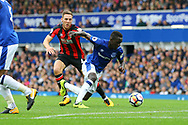Idrissa Gueye of Everton takes a tumble under pressure from Dan Gosling of Bournemouth but the referee says no foul. Premier league match, Everton vs Bournemouth at Goodison Park in Liverpool, Merseyside on Saturday 23rd September 2017.<br /> pic by Chris Stading, Andrew Orchard sports photography.