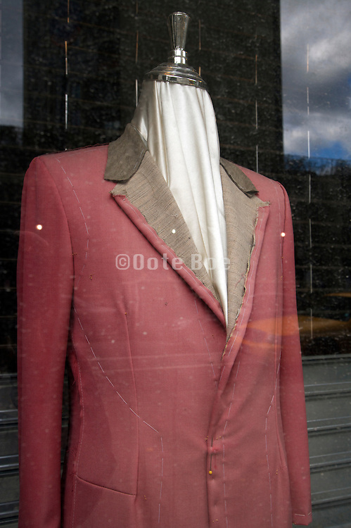 tailors costum made jacket displayed in window