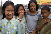 On the outskirts of Barangay Tambo in Paranque Philippines shanty's jut up against commercial areas of manufacturing and near the international airport.  Known in the Philippines as squatter areas poverty continues to remain a dominant issue in national and local govenrment. President Gloria Macapagal-Arroyo has been symbolized by radical and risky moves pushing towards faster and more rapid economic growth. In recent years, Arroyo's stance towards economic improvement since 2004 have seen the Philippines re-emerge as one of the growing economies in Southeast Asia...Photo by Jason Doiy.6-15-08
