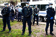 Police guarding as protesters are arrested during the Black Lives Matter rally. This event was organised to rally against black deaths in custody in Australia as well as George Floyd, an unarmed black man killed at the hands of a police officer in Minneapolis, Minnesota and David Dungay who died in custody at Long Bay prison in Sydney. (Photo by Pete Dovgan/ Speed Media)