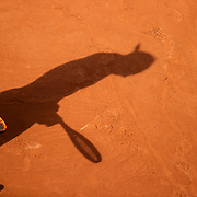 PARIS, FRANCE June 5.  The shadow of Rafael Nadal of Spain on the clay court surface as he prepares to serve against Cameron Norrie of Great Britain on Court Suzanne Lenglen during the third round of the singles competition at the 2021 French Open Tennis Tournament at Roland Garros on June 5th 2021 in Paris, France. (Photo by Tim Clayton/Corbis via Getty Images)