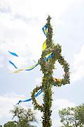 Midsommar Pole with yellow and blue ribbons. Svenskarnas Dag Swedish Heritage Day Minnehaha Park Minneapolis Minnesota USA