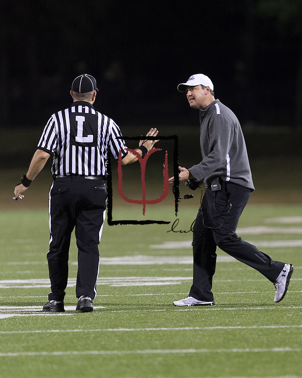 Cedar Ridge head coach Todd Ford attempts to discuss a call with a referee in the first half against Bowie at Kelly Reeves Athletic Complex.  (LOURDES M SHOAF for Round Rock Leader)