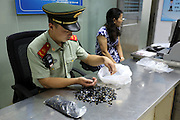 SHENZHEN, CHINA - JUNE 07: (CHINA OUT) <br /> <br /> A woman is arrested as she illegally hid 3,000 memory cards at her private part on June 7, 2016 in Shenzhen, Guangdong Province of China. Armed police of Guangdong Frontier Defense Bureau arrested a woman tying 220,000 US dollars on her legs and a woman hiding over 3,000 memory cards at her private part when they were checked at the entry to Shenzhen on Tuesday.<br /> ©Exclusivepix Media