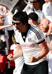 Fulham fans celebrate as Tom Cairney of Fulham scores during the Sky Bet play off final to make it 1-0 - Mandatory by-line: Dougie Allward/JMP - 26/05/2018 - FOOTBALL - Wembley Stadium - London, England - Aston Villa v Fulham - Sky Bet Championship Play-off Final