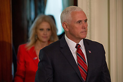 April 27, 2018 - Washington, DC, USA - Vice President Mike Pence and Trump senior aide Kellyanne Conway enter the East Room ahead of a press conference with German Chancellor Angela Merkel and U.S. President Donald Trump. (Credit Image: © Michael Candelori via ZUMA Wire)