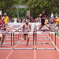 Rehoboth Lynx Emma Egan, right, competes in the 100 meter hurdles at the NMAA 2A track and field state finals in Albuquerque Friday.