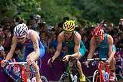 London, UK. Tuesday 7th August 2012. Men's Triathlon held in Hyde Park. Competing athletes from Russia, Australia and Belgium take part in the cycle section of the race.