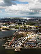 Nederland, Noord-Holland, Gemeente Heerhugowaard, 16-04-2012; verstedelijking van een polder, nieuwbouwwijken van Heerhugowaard in de gelijknamige polder. In de voorgrond de wijk 'Stad van de zon', vrijwel alle huizen zijn voorzien van zonnecollectoren. Noordzee aan de horizon..Urbanisation of a polder in Heerhugowaard (NW Netherlands)  , new residential areas and urban sprawl. City of the Sun district, houses covered in solar panels. North sea on the horizon. luchtfoto (toeslag), aerial photo (additional fee required);.copyright foto/photo Siebe Swart