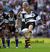 Twickenham. England. RFU Stadium, Surrey. <br /> Photo Peter Spurrier25/05/2003<br /> 2003 - Rugby - England v Barbarians.<br /> Percy Montgomery kicking for touch<br /> Left Jerry Collins centre AJ Venter.         [Mandatory Credit: Peter SPURRIER/Intersport Images]