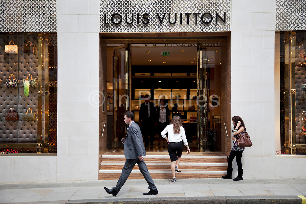 """Louis Vuitton. Exclusive shops on New Bond Street, Mayfair, central London. It is one of the principal streets in the West End shopping district and is more upmarket. It has been a fashionable shopping street since the 18th century. Technically """"Bond Street"""" does not exist: The southern section is known as Old Bond Street, and the northern section, which is rather more than half the total length, is known as New Bond Street. The rich and wealthy shop here mostly for high end fashion and jewellery."""