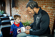 SHOT 12/10/17 1:02:34 PM - Former Buffalo Bills wide receiver and Hall of Fame player Andre Reed signs autographs and meets with fans at LoDo's Bar and Grill in Denver, Co. as the Buffalo Bills played the Indianapolis Colts that Sunday. Reed played wide receiver in the National Football League for 16 seasons, 15 with the Buffalo Bills and one with the Washington Redskins. (Photo by Marc Piscotty / © 2017)