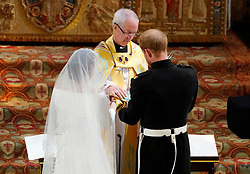 Archbishop of Canterbury Justin Welby joins the hands of Prince Harry and Meghan Markle after they exchanged vows in St George's Chapel at Windsor Castle during their wedding service.
