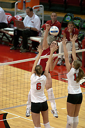 09 OCT 2005 Redbird Laura Doornbos springs one on Braves Jenna Harrison and Amber DeBroux.The Illinois State University Redbirds hosted arch rival Bradley University Braves.  The Redbirds soared over the Braves, taking the match in 4 games, losing only game number 2.  Action included play by Braves Star Lindsey Stalzer who is ranked no. 7 in the nation in kills per game.  The first defeat of the conference season for the Braves took place at Redbird Arena on Illinois State's campus in Normal IL.