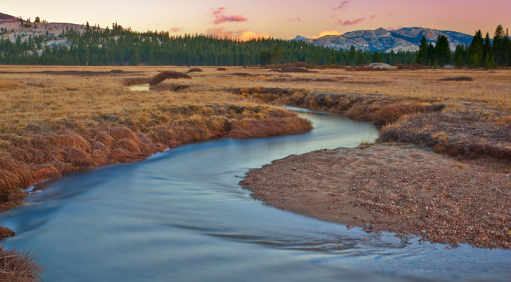 tuolumne meadows in the fall at sunset just after a clearing storm taken using a wide angle lens to take in all the grandeur of the river