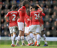 Manchester United's Shinji Kagawa celebrates after his team-mate Danny Welbeck (right) scored his team's third goal