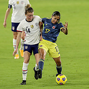 ORLANDO, FL - JANUARY 22:  Emily Sonnett #14 of United States  and Carolina Arias #17 of Columbia fight for the ball at Exploria Stadium on January 22, 2021 in Orlando, Florida. (Photo by Alex Menendez/Getty Images) *** Local Caption *** Emily Sonnett; Carolina Arias