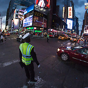 A traffic officer controls traffic in Times Square in New York City on Sunday, September 27, 2015. This image was captured with an 8mm fisheye lens.  (Alex Menendez via AP)