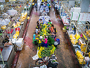 17 MAY 2013 - BANGKOK, THAILAND:   Vendors in the flower market in Bangkok. The Bangkok Flower Market (Pak Klong Talad) is the biggest wholesale and retail fresh flower market in Bangkok. It is also one of the largest fresh fruit and produce markets in the city. The market is located in the old part of the city, south of Wat Po (Temple of the Reclining Buddha) and the Grand Palace.   PHOTO BY JACK KURTZ