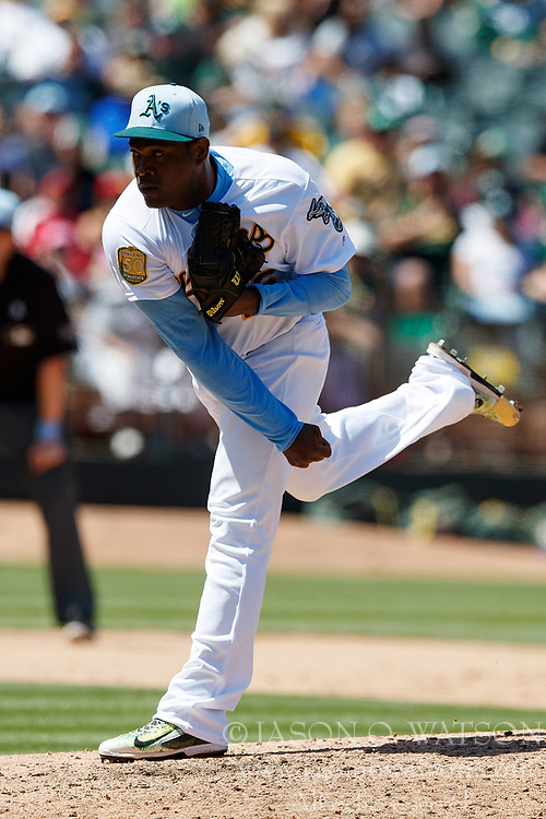 OAKLAND, CA - JUNE 17: Santiago Casilla #46 of the Oakland Athletics pitches against the Los Angeles Angels of Anaheim during the eighth inning at the Oakland Coliseum on June 17, 2018 in Oakland, California. The Oakland Athletics defeated the Los Angeles Angels of Anaheim 6-5 in 11 innings. (Photo by Jason O. Watson/Getty Images) *** Local Caption *** Santiago Casilla
