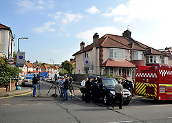 © Licensed to London News Pictures. 23/09/2011. LONDON, UK. The street has been closed since the fire. Six people, including three children, two teenagers and an adult have died following a house fire in Neasden, North West London today (24 Sept 2011). Emergency services were called tot he blaze in the early hours of the morning. Photo credit:  Stephen Simpson/LNP