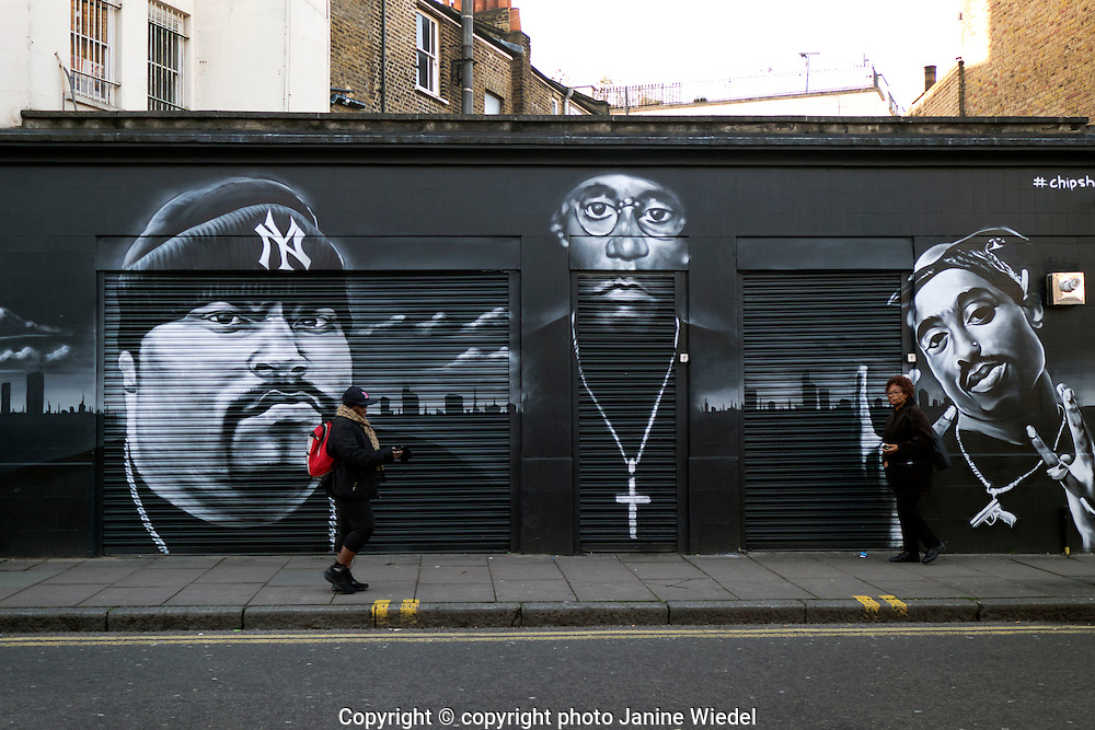 Mural by titlegraffiti of rap icons part of Save Brixton Campaign from gentrification and eviction of shops by Network Rail Atlantic Road Brixton South London