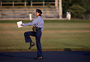 Woman graduate of US Navy Basic training practices marching