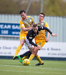 Falkirk's John Baird brought down for a penalty.  <br /> half time : Falkirk 0 v 0 Morton, Scottish Championship game  played 1/5/2016 at The Falkirk Stadium.