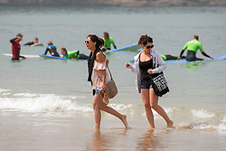 Holidaymakers at Fistral Beach in Newquay, Cornwall.