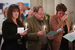 © Licensed to London News Pictures.  17/11/2013. THAME, UK. Members of the congregation sing a hymn during the annual Road Deaths Memorial Service held in St Marys Church, Thame. In this picture: Joanne Parker (right). 78 people were killed in traffic accidents in the Thames Valley Police area last year.  Photo credit: Cliff Hide/LNP