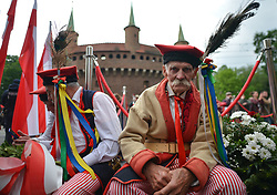 May 3, 2019 - Krakow, Poland - A group of elderly men dressed in a traditional Krakow area folk  costumes seat outside Barbakan. .Hundreds take part of the patriotic march from Wawel Hill trough Krakow's Old Town on Polish Constitution Day. The Constitution of 3 May, 1791, was the world's second-oldest codified national constitution, but remained in force only for less than 19 months. By 1795, the Second and Third Partitions of Poland ended the existence of the sovereign Polish state. Over the next 123 years, the Constitution of 3 May was seen as proof of successful internal reform and as a symbol promising the eventual restoration of Poland's sovereignty. In April 1919 under the Second Polish Republic, May 3rd was the first holiday officially introduced in the newly independent Poland, but again outlawed during World War II by both the Nazi and Soviet occupiers, and finaly restored as an official Polish holiday in April 1990 after the fall of communism..On Friday, May 5, 2019, in Krakow, Poland. (Credit Image: © Artur Widak/NurPhoto via ZUMA Press)