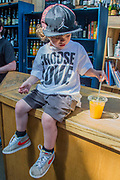 A young boy with a Choose Love t-shirt is taken on a tour by his father, buying juice, macaroons, beer and ice cream - The market reopening is signified by the ringing of the bell and is attended by Mayor Sadiq Khan. Tourists and locals soon flood back to bring the area back to life.