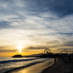 Santa Monica Pier at sunset along the Pacific Ocean in Southern California. Copyright ⓒ 2017 Paul Velgos with All Rights Reserved.