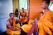 Apr. 3, 2010 - KHUN SAMUTCHINE, THAILAND: Monks in their living quarters at Wat Samutchine. Rising sea levels brought about by global climate change threaten the future of Khun Samutchine, a tiny fishing village about 90 minutes from Bangkok on the Gulf of Siam. The coastline advances inland here by about 20 metres (65 feet) per year causing families to move and threatening the viability of the village. The only structure in the village that hasn't moved, their Buddhist temple, is completely surrounded by water and more than 2 kilometers from the village. The temple and the village have asked the Thai government and several NGOs for help, but the only help so far is a narrow concrete causeway the government is building that will allow people to walk into the temple from a boat landing two miles away. The walk to the village from a closer boat landing is shorter, but over an unimproved mud flat that is nearly impassible in the rainy season.  PHOTO BY JACK KURTZ