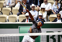 May 27, 2019 - Paris, France - France's Jo-Wilfried Tsonga returns the ball to Germany's Peter Gojowczyk during their men's singles first round match on day two of The Roland Garros 2019 French Open tennis tournament in Paris on May 27, 2019. (Credit Image: © Ibrahim Ezzat/NurPhoto via ZUMA Press)