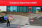 April 7, 2020, London, England, United Kingdom: A woman holding up signs (PPE-Personal Protection Equipment) stands outside St Thomas' Hospital in central London as British Prime Minister Boris Johnson is in intensive care fighting the coronavirus in London, Tuesday, April 7, 2020. (Credit Image: © Vedat Xhymshiti/ZUMA Wire)