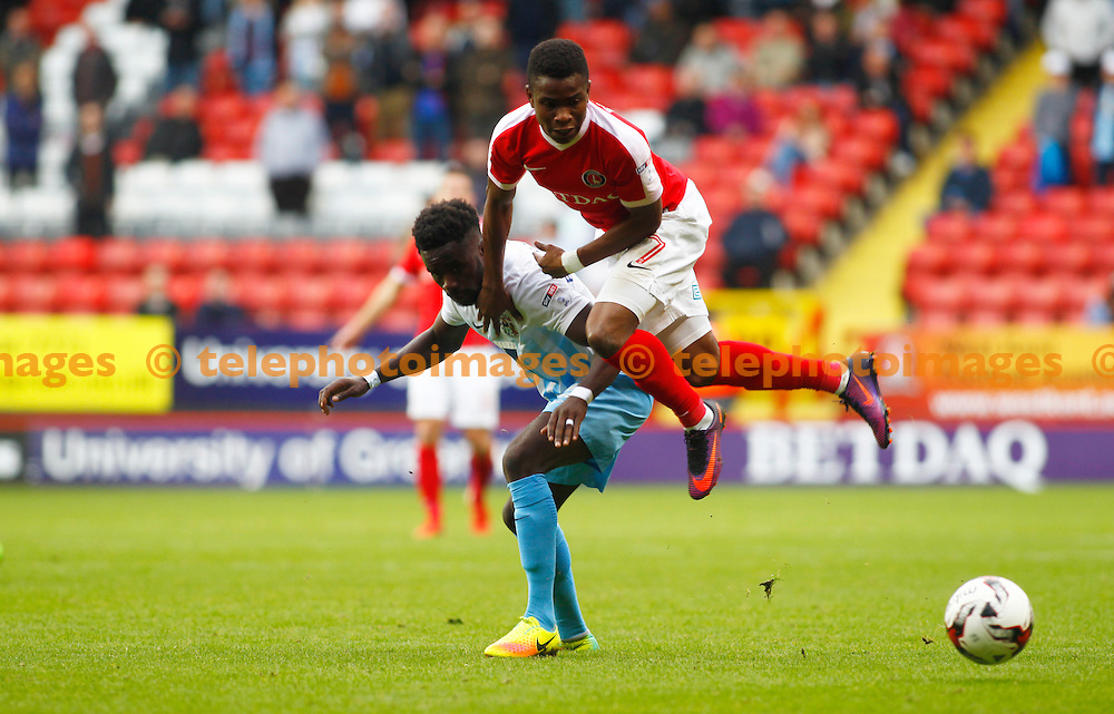 Charlton Athletic's Ademola Lookman and Coventry City's Gael Bigirimana during the Sky Bet League 1 match between Charlton Athletic and Coventry City at The Valley in London. October 15, 2016.<br /> John Marsh / Telephoto Images<br /> +44 7967 642437