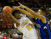 Gary Breaux (23) of Dallas Triple A Academy is defended by Josh Sustaita (21) of Mumford during the UIL 1A division 1 state championship game at the Frank Erwin Center in Austin on Friday, March 8, 2013. (Cooper Neill/The Dallas Morning News)