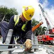 Worker preparing instillation of Transmission Tower for new line.