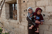 El Qaa, Lebanon, 30 meters from the border with Syria. This woman and child are Syrian refugees who came from Nizarié. They have been living with 11 persons in a 1 room house without water or electricity for 3 months.