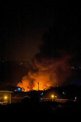Firefighters are tackling a large blaze at a single storey warehouse on a Sheffield Industrial Estate just off Station Road in Ecclesfield close to South Yorkshire Police Sub Divisional HQ and Chapeltown Academy. The fire started just after 9.30pm this evening and a number of loud explosions have been heard during the course of the night.<br /> <br /> 3 September 2014<br /> <br /> Image © Paul David Drabble