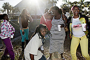 "Gail McIntosh, from right, and Tifffany Carter, Nana McCarter, 10, left, and Cisalyn Thomas, second from left, dance to to the song ""In My Project"" by Fort Myers rappers TimWes and Buck Town Gutta Gutta during a block party video shoot at Clemente Park in Fort Myers."