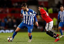 Brighton & Hove Albion's Davy Propper (left) and Manchester United's Jesse Lingard battle for the ball during the Emirates FA Cup, quarter final match at Old Trafford, Manchester.