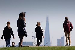 © Licensed to London News Pictures. 23/03/2020. London, UK. People walk in the sunshine on Primrose Hill as the coronavirus pandemic escalates in the capital. Photo credit: Peter Macdiarmid/LNP