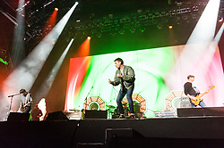 © Licensed to London News Pictures. 13/06/2015. Isle of Wight, UK.   Blur performing live at Isle of Wight Festival 2015, Day 3 Saturday,headlining the main stage.   In this picture - Graham Coxon (left), Damon Albarn (middle), Alex James (right).  Headline acts include The Prodigy, Blur and Fleetwood Mac.   Photo credit : Richard Isaac/LNP