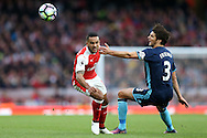 Theo Walcott of Arsenal and George Friend of Middlesbrough in action. Premier league match, Arsenal v Middlesbrough at the Emirates Stadium in London on Saturday 22nd October 2016.<br /> pic by John Patrick Fletcher, Andrew Orchard sports photography.