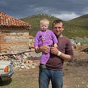 Matteo (1) and Renato (23) outside their house in the village of Rakicke, Albania