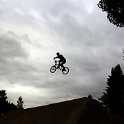 Alan Cameron in action during the 'Red Bull Roast It' BMX competition with riders from around the globe competing at the Gorge Road Jump Park, Queenstown, South Island, New Zealand. 18th February 2012. Photo Tim Clayton
