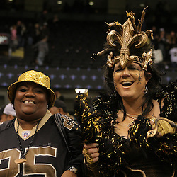 16 January 2010:  New Orleans Saints fans celebrate in the stands following a 45-14 win by the New Orleans Saints over the Arizona Cardinals in the 2010 NFC Divisional Playoff game at the Louisiana Superdome in New Orleans, Louisiana.